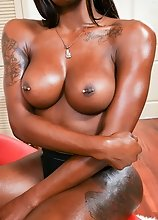 Black tgirl Kendra Kellz has an amazing body, big boobs and a juicy ass! Watch her posing and stroking her cock in this hot solo scene!