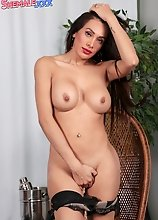 Diana Love is a sexy American tgirl who shows off her big boobs and nice body. She then starts pleasing herself by stroking her cock.