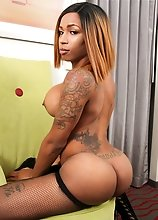 Watch black tgirl Alana Longcawk posing, stripping and stroking her big cock!