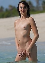 Hot transsexual Jonelle posing in the water