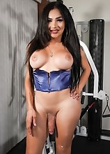 Kimmie Bombshell stroking her cock until she shoots a nice sticky load in this solo scene!